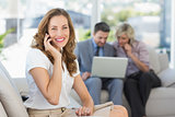 Businesswoman on call with colleagues using laptop