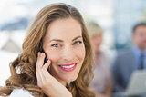 Beautiful businesswoman using mobile phone