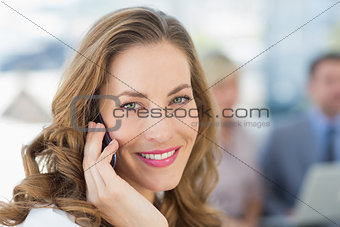 Beautiful businesswoman using mobile phone