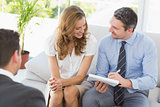 Smiling couple in meeting with a financial adviser