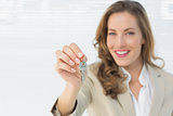 Portrait of a beautiful woman holding house keys