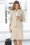 Businesswoman text messaging while on a business trip