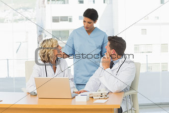 Three concentrated doctors in discussion