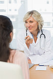 Friendly female doctor in conversation with patient
