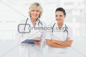 Portrait of two confident female doctors