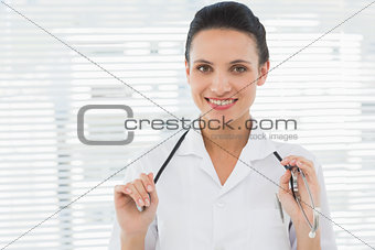 Beautiful confident female doctor with stethoscope