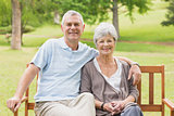 Senior couple sitting on bench at park