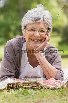 Closeup of a senior woman lying at park