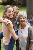 Portrait of grandmother, mother and daughter at park