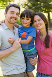 Portrait of a couple with little son at park