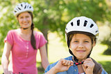 Smiling woman with her daughter riding bicycle