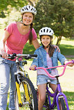 Woman with her daughter riding bicycles