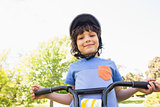 Cute little boy riding a bicycle