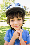 Cute little boy wearing bicycle helmet