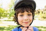 Cute little boy wearing bicycle helmet