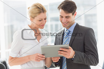 Business team looking at tablet pc together