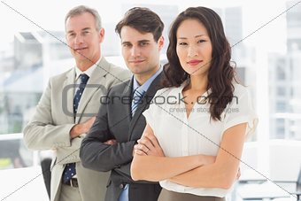 Business team standing in a row smiling at camera