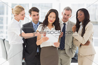 Business team looking at document together