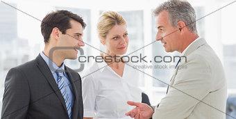 Smiling business team talking together