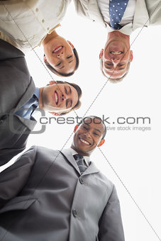 Business team smiling down at the camera