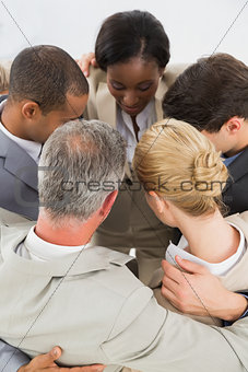 Close business team hugging in a circle