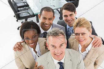 Close business team smiling up at camera