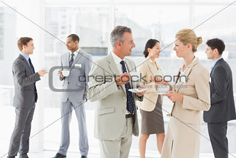 Business people chatting at a conference