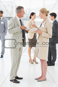 Business people chatting and having coffee at a conference