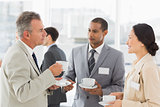 Business people talking and having coffee at a conference