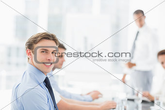 Smiling businessman looking at camera during a meeting