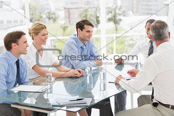 Smiling business people talking during a meeting