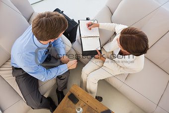 Business team working together on the couch scheduling in diary