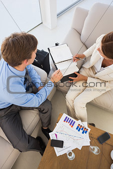 Business team working on the couch scheduling in diary