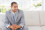 Smiling businessman sitting on sofa