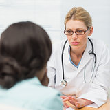 Concerned doctor talking to her patient