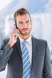 Handsome young businessman using mobile phone