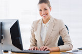 Businesswoman using computer at office desk