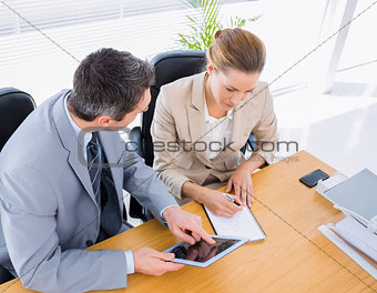 Smartly dressed colleagues in business meeting