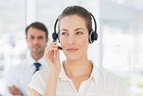 Closeup of a beautiful female executive with headset