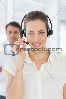 Beautiful female executive with headset