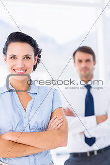 Portrait of a young businesswoman with arms crossed