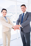 Cheerful business colleagues joining hands together