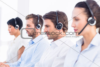 Group of business colleagues with headsets in a row