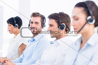 Business colleagues with headsets in a row