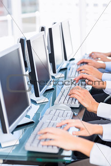 Business colleagues using computers
