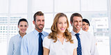 Confident and happy business team together in office