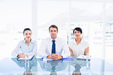 Smartly dressed young executives sitting at desk