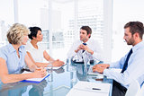 Executives sitting around conference table