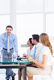 Executives around conference table in office