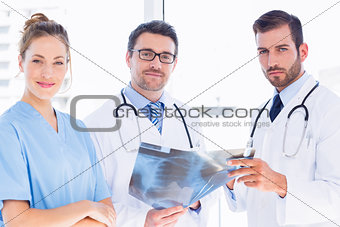 Portrait of doctors with xray report